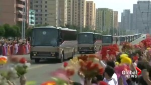 Cheering crowds greet North Korea's nuclear scientists